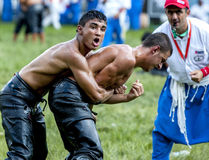 Teenage wrestlers battle for supremacy during competition at the Kirkpinar Turkish Oil Wrestling Festival in Edirne, Turkey. Stock Photo