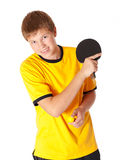 Teenage in yellow T-shirt playing ping pong Stock Photos