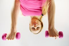 Teenage woman working out at home with dumbbell Royalty Free Stock Photography
