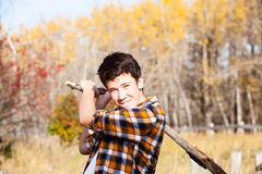 Teen boy swinging a stick Stock Images