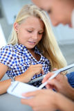 Teenaged girl websurfing on internet Stock Images