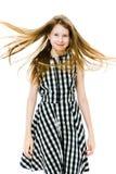 Teenaged modelmeisje met lange rechte vliegende haren royalty-vrije stock foto's