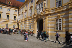 Teenaged students leave the abbey school. MELK, AUSTRIA - SEP 7, 2016 - Teenaged students leave the abbey school in  Melk, Austria Stock Photo