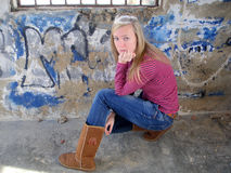 Teenager. Sitting near the wall Stock Image