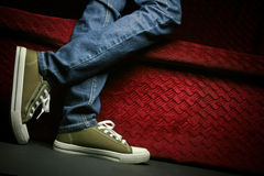 A teenager. Showing his/her shoes and jeans, posing in studio Royalty Free Stock Photo