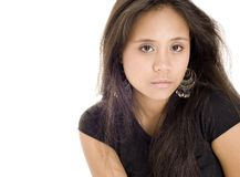 Teenager 17. A serious looking pretty young asian woman in black on white Royalty Free Stock Photography
