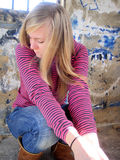 Teenager. Teenager sitting near the wall Stock Photography