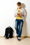 Teenager. Boy is using phone at school Royalty Free Stock Images