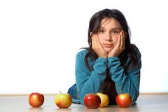 Teenager. Girl lying on her stomach with apples in front of her Stock Image