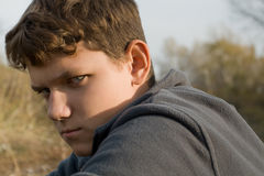 Teenager. Portrait of the teenager on nature background. Severe glance Stock Photos