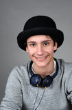Teenager. Boy with earphones  and hat Royalty Free Stock Photography