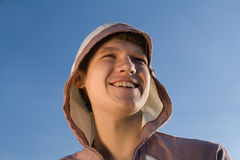 Teenager. Portrait of teenager on blue sky background Royalty Free Stock Photos