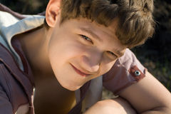 Teenager. Portrait of teenager. Close-up. Cunning glance Royalty Free Stock Photography