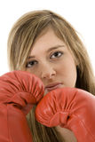 Teenager. Young Caucasian teenager in red boxing gloves getting ready to fight royalty free stock image