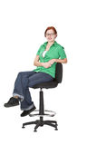 Teenager. Relaxed smiling redheaded girl sitting on a high chair isolated against a white background Stock Images