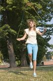 Teenager. Jumps on skipping rope Stock Image