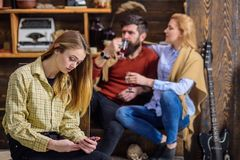 Teenager absorbed with gadget and not talking to parents, generation gap, rebellious youth concept. Bearded man and. Teenager absorbed with gadget and not royalty free stock images
