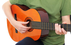 Teenager with acoustic guitar. Isolated on white Royalty Free Stock Images