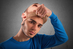 Teenager with adult mask Stock Photos