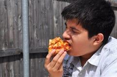 Teenager affamato Fotografia Stock