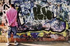 Teenager against graffiti wall. Stock Images