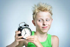 Teenager with alarm clock Royalty Free Stock Photos