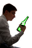 Teenager in Alcohol Addiction. Silhouette of Depressed Young Man in Alcohol addiction on the White Background Stock Photography