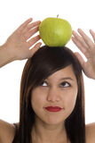 Teenager with apple at the head Stock Photos