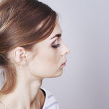 Teenager applying make-up by artist. Royalty Free Stock Photo