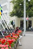 A teenager with Arab headscarves. THE HAGUE, NETHERLANDS - JULY 7, 2015: A teenager with Arab headscarves, rests between flowerbeds in the city center Stock Photo