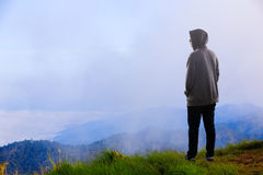 Teenager asian boy standing at mountain stock images