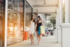 Teenager asian women walking and doing shopping together. stock photos