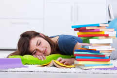 Teenager asleep by the book Stock Image