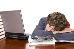 Teenager asleep studying for examination Stock Photos