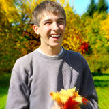 Teenager with Autumn Leafs Royalty Free Stock Image