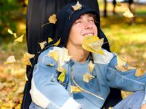 Teenager in autumn park Stock Photo