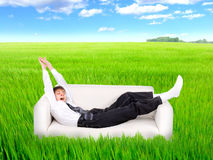 Teenager awake in the field Stock Photography