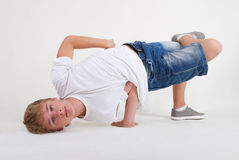 Teenager b-boy in freeze Stock Images