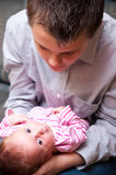 Teenager with baby. Teenager boy holding his baby girl sister Stock Image