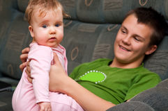 Teenager with baby girl Royalty Free Stock Photo