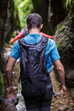 Teenager with backpack on a canyon Royalty Free Stock Image