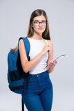Teenager with backpack holding pencil and notebook Royalty Free Stock Images