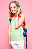 Teenager with backpack listening to music Royalty Free Stock Image