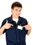 Teenager with a Badge. Happy Teenager with Blank Badge on the Shirt on the White Background Royalty Free Stock Photo