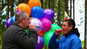 Teenager with balloons in birthday party stock video