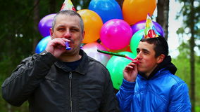 Teenager with balloons in birthday party stock footage