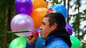 Teenager with balloons in birthday party stock video footage