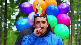 Teenager with balloons in birthday party Royalty Free Stock Photography