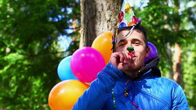 Teenager with balloons in birthday party Stock Images
