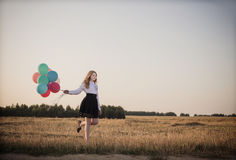 Teenager balloons in summer field. The teenager with balloons in summer field Stock Photos